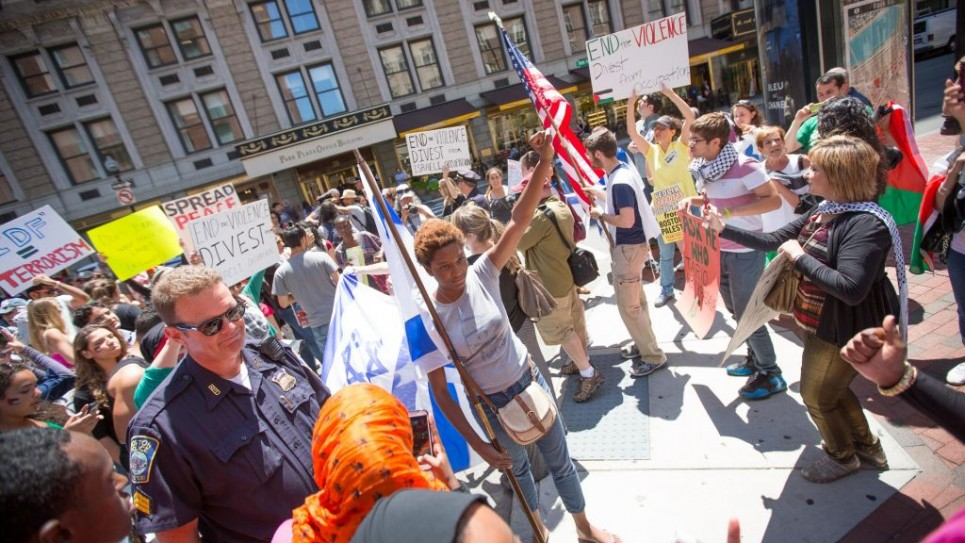 At an anti-Israel protest in Boston on Friday, pro-Palestinian activists surrounded several Israel supporters, hurling insults and allegedly physically assaulting pro-Israel students (photo credit: Elan Kawesch/The Times of Israel)