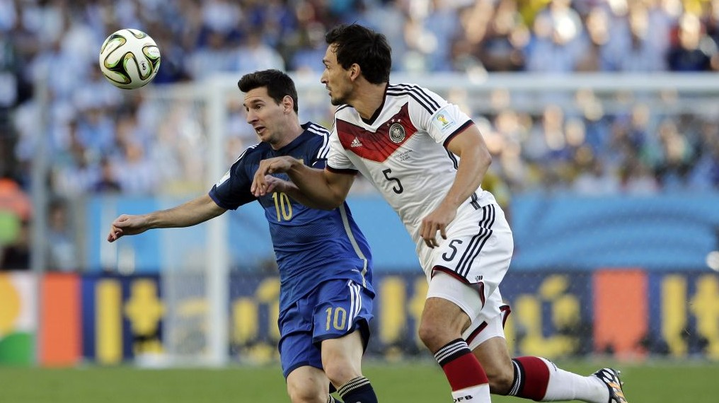 Argentina's Lionel Messi, left, battles for the ball with Germany's Mats Hummels during the World Cup final soccer match between Germany and Argentina at the Maracana Stadium in Rio de Janeiro, Brazil, Sunday, July 13, 2014. (photo credit: AP Photo/Matthias Schrader)