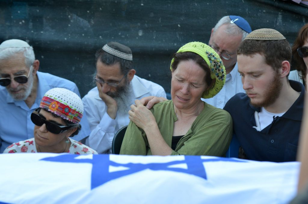 Rachelle Fraenkel crying over the body of her son Naftali at his funeral (photo credit: Flash90)
