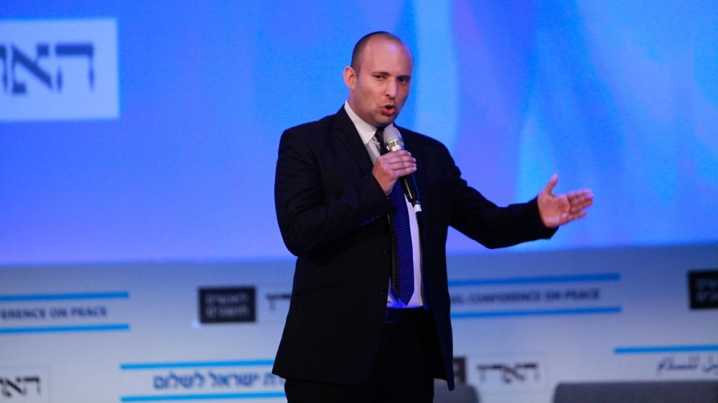 Economy Minister Naftali Bennett speaks at the Israel Conference for Peace, which opened today at David Intercontinnental Hotel in Tel-Aviv, Tuesday July 8, 2014. (photo credit: Flash90)