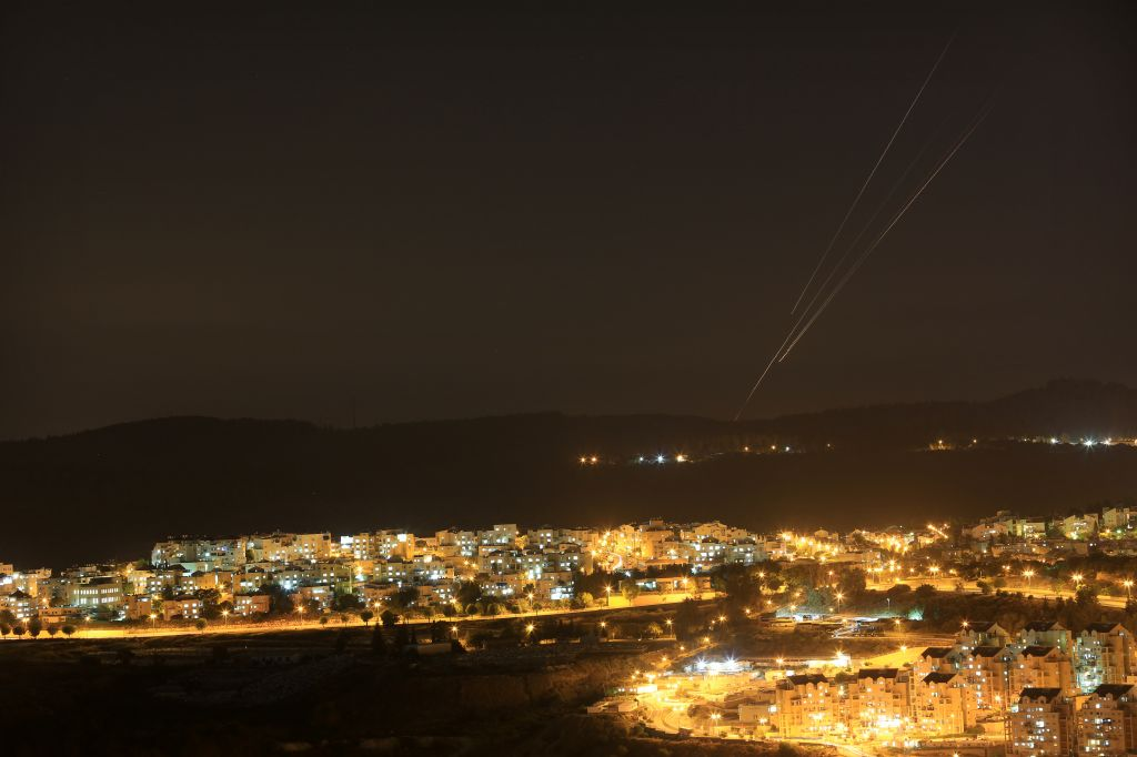 Rockets seen flying over central Israel on the fifth day of Operation Protective Edge. Over 500 rockets have been fired from Gaza at Israel over the past five days. July 12, 2014. (photo credit: Nati Shohat/Flash90)