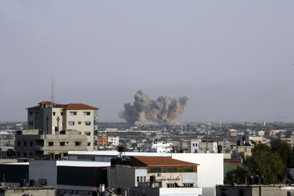 Smoke rises following an Israeli strike on Rafah in the southern Gaza Strip on July 13, 2014. (photo credit: Abed Rahim Khatib/Flash90)