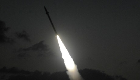 An Iron Dome Missile Defense battery set in the Ashdod area, fires an intercepting missile, on July 13, 2014. (Photo credit: David Buimovitch/Flash90)