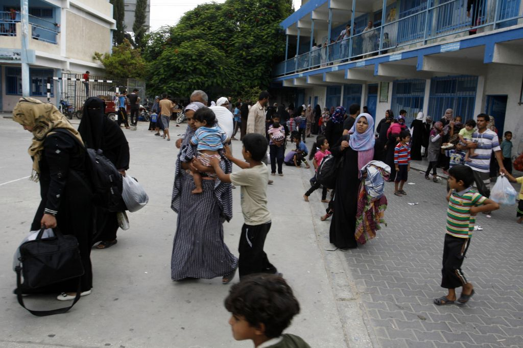 Palestinians at an UNRWA school after fleeing their homes following an Israeli ground offensive in Rafah in the southern Gaza Strip on July 18, 2014. (Photo credit: Abed Rahim Khatib/Flash90)