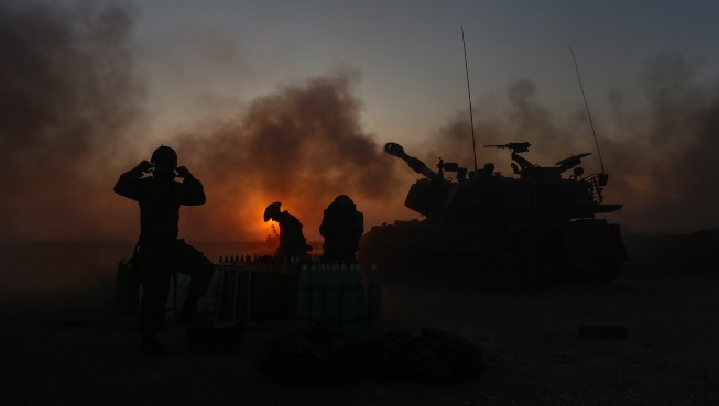 IDF Artillery Corps seen firing shells to Gaza, near the border in Southern Israel on July 21, 2014, on the fourth day of the Israeli ground invasion into Gaza Strip in order to destroy the Hamas' terror tunnels infrastructure, and the 14th day of Operation Protective Edge. (Photo credit: Yonatan Sindel/Flash90)