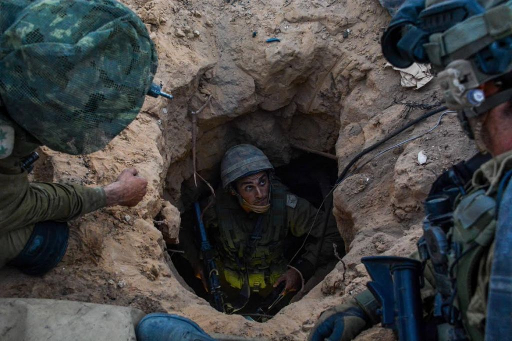 Soldiers from the Givati brigade seen at the entrance to a Hamas 'attack tunnel' on Wednesday, July 23. The brigade's mission is to target Hamas' tunnels that cross under the Israel-Gaza border and enable Hamas terrorists to infiltrate into Israel and carry out attacks. (Photo credit: IDF Spokesperson/FLASH90)