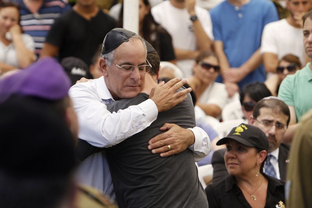 Stuart Steinberg and his son, Jake, haltingly recited the mourner's prayer in front of a crowd of thousands (photo credit: Miriam Alster/Flash 90)