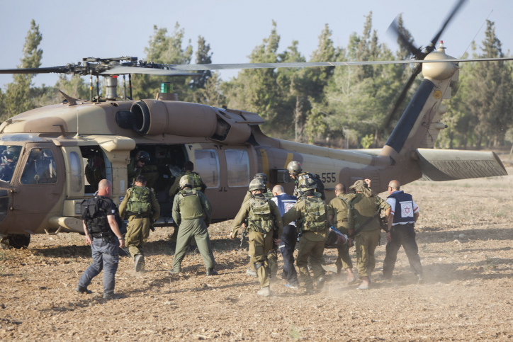 An injured Israeli soldier is evacuated by helicopter from near the Israeli border with Gaza Strip on July 28, 2014, (photo credit: Yonatan Sindel/Flash90)