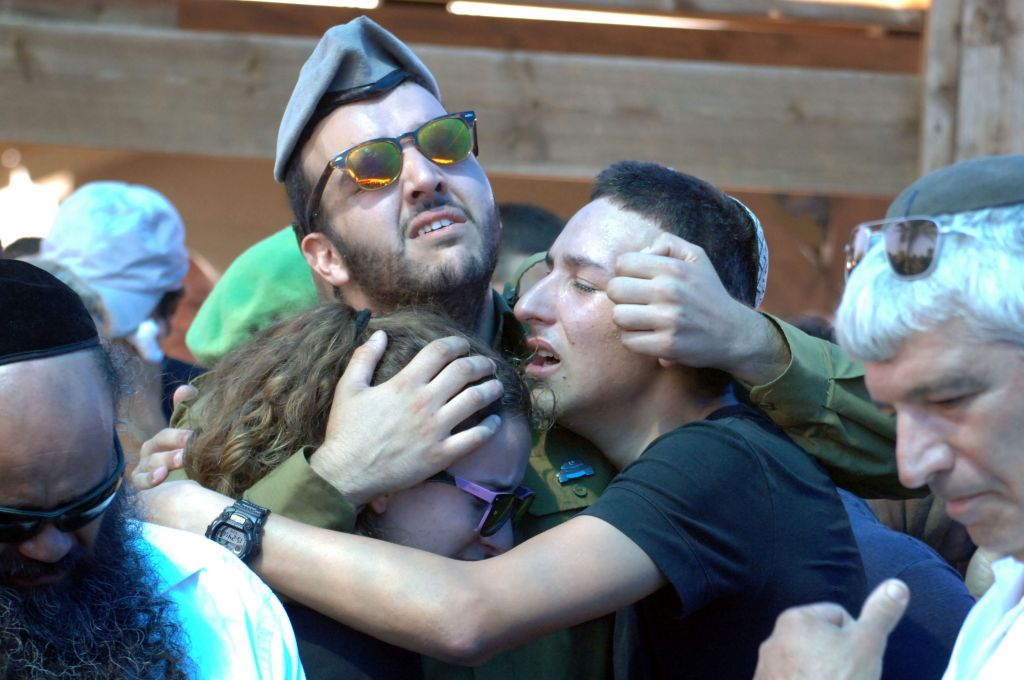 Relatives seen mourning during the funeral of corporal Meidan Biton at the Netivot Cemetery on July 29, 2014 (photo credit: Flash90)
