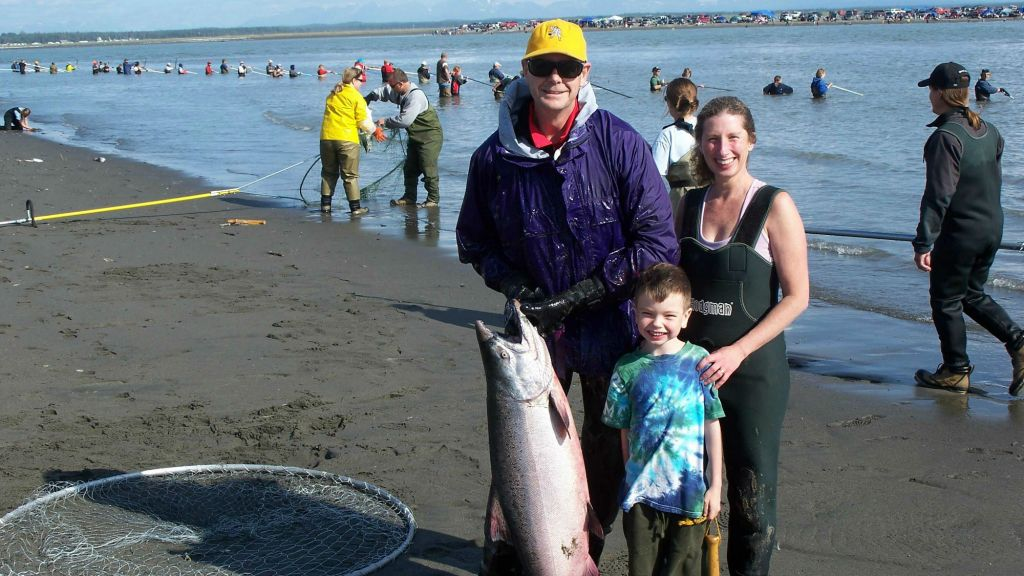 Stewart, Liam and Karen Ferguson, left to right, who are making aliyah, holds large king salmon that they caught in Alaska (photo credit: Stewart Ferguson)