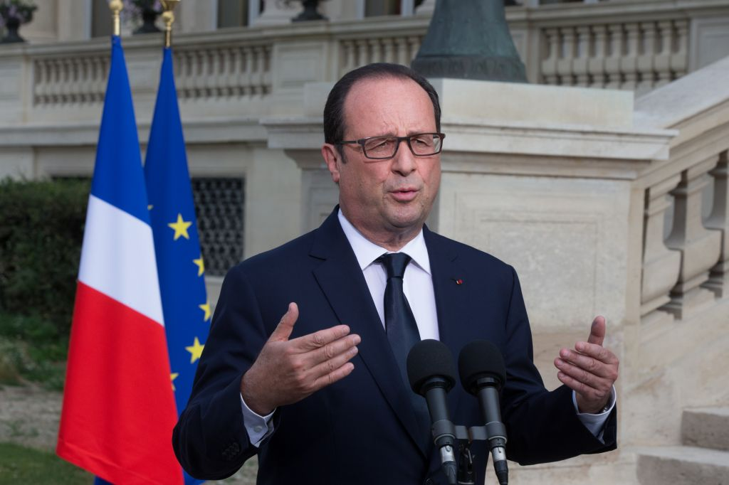 French President Francois Hollande outside the Foreign Affairs ministry in Paris, Saturday, July 26, 2014, after meeting families of the victims of Air Algeria flight crash, that killed all 118 people onboard including 54 French citizens. (photo credit: AP/Philippe Wojazer, Pool)