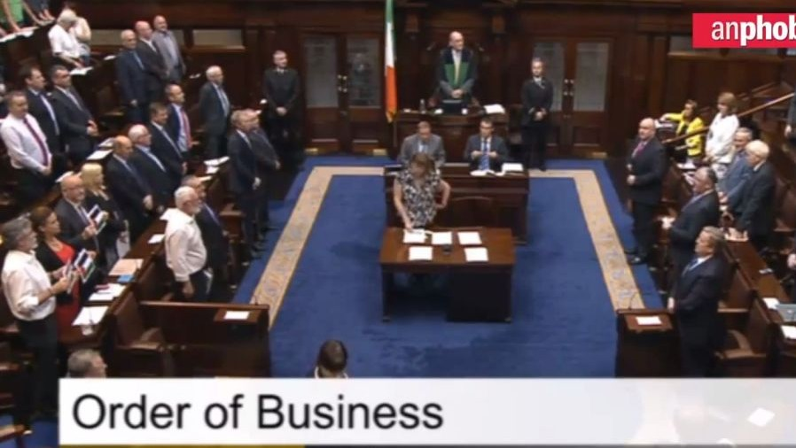 Gerry Adams (bottom left) leads a minute's silence for Gaza in the Irish parliament (Belfast Telegraph screenshot)