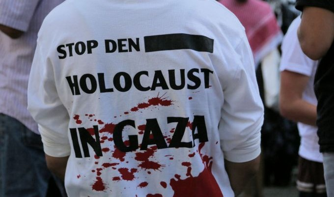 Stop the Holocaust in Gaza: A pro-Palestinian protester at a Berlin rally Friday, July 18, 2014. (Micki Weinberg/The Times of Israel)