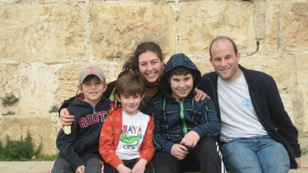 Rabbi Yael Splansky and her husband Adam Sol on a trip to Jerusalem with their three young sons. (Courtesy)