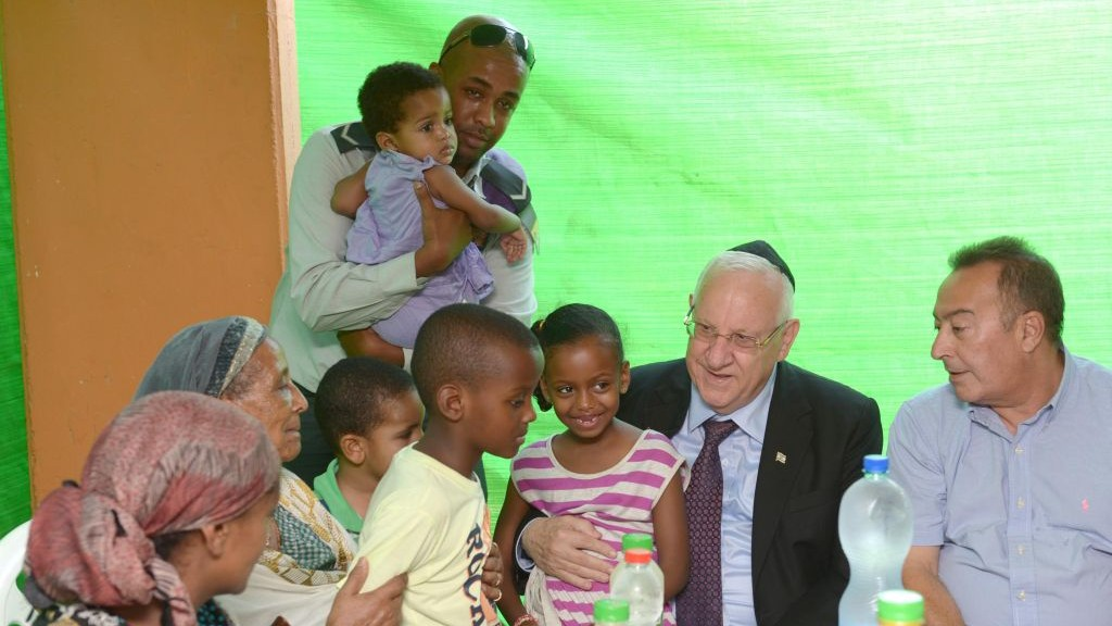 President Reuven Rivlin pays a visit to the family of a wounded soldier, Monday, July 28, 2014. (photo credit: Mark Neiman/GPO)