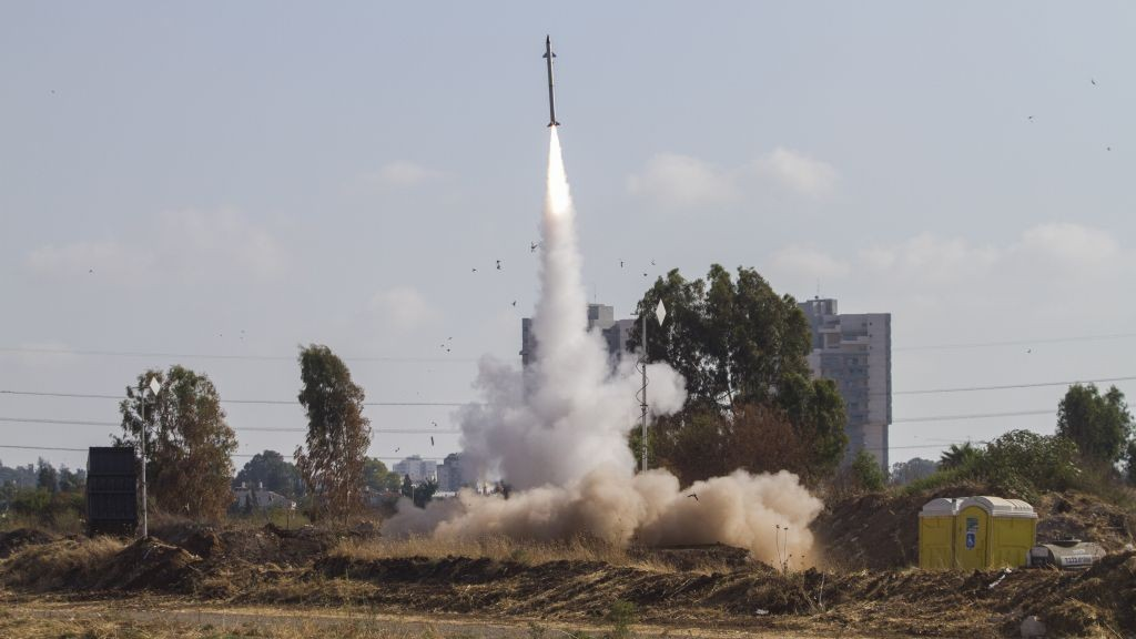 An Iron Dome air defense system fires to intercept a rocket from the Gaza Strip in Tel Aviv, Israel, on Wednesday, July 9, 2014. (photo credit: AP/Dan Balilty)