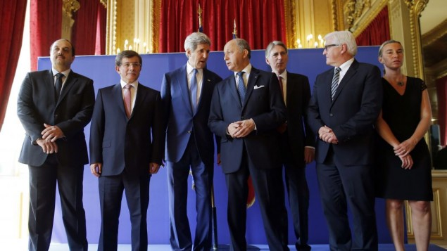U.S. Secretary of State John Kerry, third from left, stands with from left, Qatari Foreign Minister Khaled al-Attiyah, Turkish Foreign Minister Ahmet Davutoglu, French Foreign Minister Laurent Fabius, British Foreign Secretary Philip Hammond, German Foreign Minister Frank-Walter Steinmeier and Italian Foreign Minister Federica Mogherini after their meeting regarding a cease-fire between Hamas and Israel in Gaza, Saturday, July 26, 2014, at the foreign ministry in Paris, France. With a 12-hour humanitarian cease-fire in Gaza Saturday, Kerry is continuing with efforts to reach a longer truce between Israel and Hamas. (photo credit: AP/Charles Dharapak)