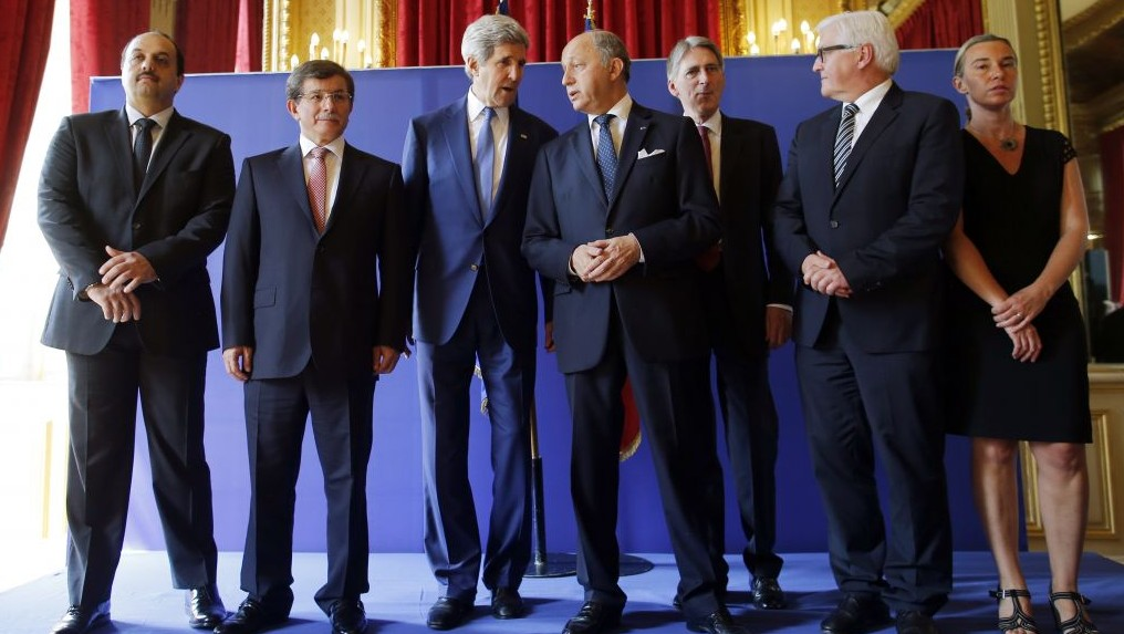 US Secretary of State John Kerry, third from left, stands with from left, Qatari Foreign Minister Khaled al-Attiyah, Turkish Foreign Minister Ahmet Davutoglu, French Foreign Minister Laurent Fabius, British Foreign Secretary Philip Hammond, German Foreign Minister Frank-Walter Steinmeier and Italian Foreign Minister Federica Mogherini after their meeting regarding a cease-fire between Hamas and Israel in Gaza, Saturday, July 26, 2014, at the foreign ministry in Paris, France. With a 12-hour humanitarian cease-fire in Gaza Saturday, Kerry is continuing with efforts to reach a longer truce between Israel and Hamas. (photo credit: AP/Charles Dharapak)