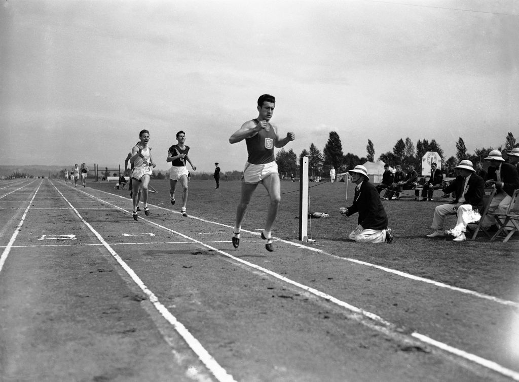 Louis Zamperini as he breaks the tape and record with a time of 4:16.3 to win the mile run in the Pacific Coast Conference Track and Field meet at the University of Washington Stadium in Seattle, May 20, 1939 (photo credit: AP/Paul Wagner)