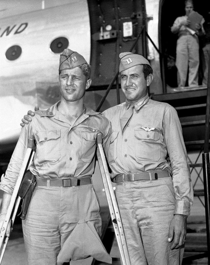 Capt. Louis Zamperini (right), former track star, who was adrift 47 days in Pacific after bombing mission against the Japanese and presumed dead, stands with Capt. Fred Garrett, Riverside, Calif., upon their arrival at Hamilton Field, California, Oct. 3, 1945.  (photo credit:AP/PCS)