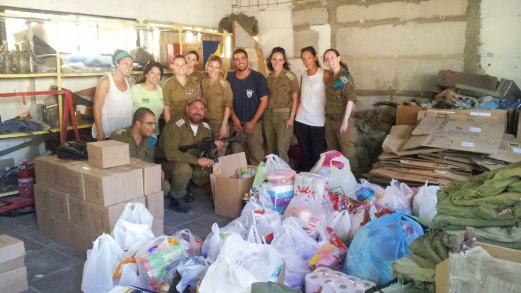 The Nefesh B'Nefesh employees with their donations on the army base. (photo credit: Debra Kamin/Times of Israel)