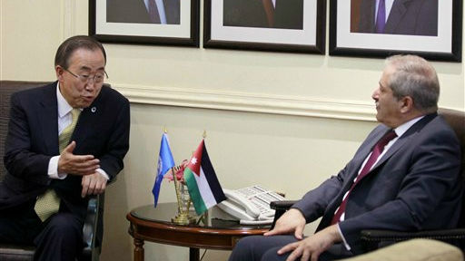 United Nations Secretary-General Ban Ki-moon, left, meets with Jordanian Foreign Minister Nasser Judeh in the capital, Amman, Jordan, Wednesday, July 23, 2014 (photo credit: AP/Khalil Mazraawi, Pool)