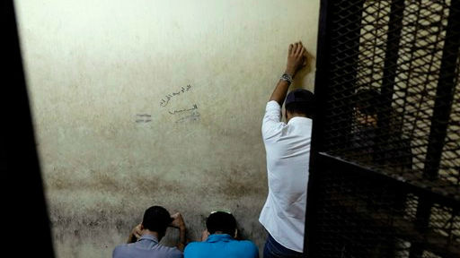 Illustrative photo: Egyptian men sentenced to life in prison for sexual assaults on women during a number of public rallies in Cairo's iconic Tahrir Square, attend their trial at a court in Cairo, Egypt, Wednesday, July 16, 2014 (photo credit: AP/Aly Hazzaa, El Shorouk)