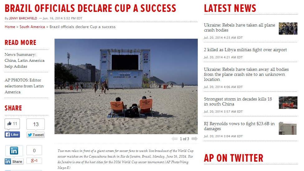 The original AP photo by Wong Maye-E, showing two men awaiting the screening of a World Cup match on the Copacabana beach in Rio de Janeiro, Brazil. (screen capture)
