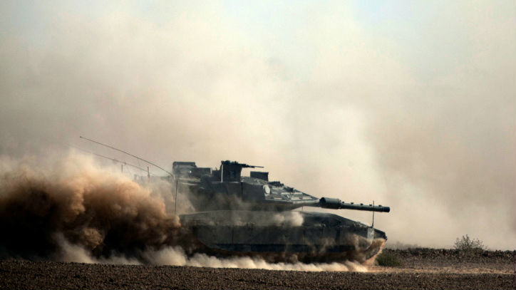 Israeli soldiers seen on Merkava tank near the Gaza border in Southern Israel, on the tenth day of Operation Protective Edge, July 17, 2014. (photo credit: Flash90)