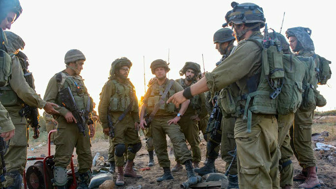 Israeli soldiers from the Givati brigade seen at the entrance to a terror tunnel. (photo credit: IDF Spokesperson/FLASH90)