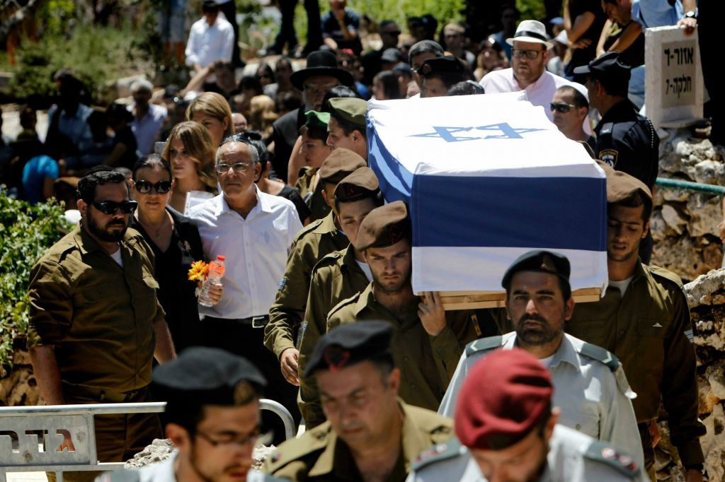 Parents, siblings and friends of IDF lone soldier Max Steinberg, killed in Gaza, follow his coffin to the burial on Mount Herzl on Wednesday morning, June 23 (photo credit: Miriam Alster/Flash 90)