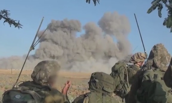 IDF ground troops look on following an Israeli strike in Gaza (Photo credit: Youtube screen capture)