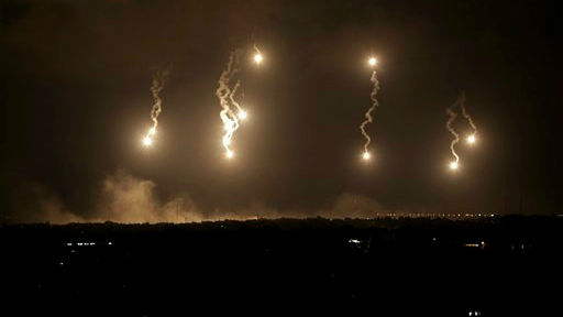 Israeli forces' flares light up the night sky in the northern Gaza Strip, early Saturday, July 19, 2014 (photo credit: AP/Adel Hana)