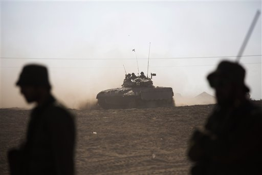 Israeli tank rides near the Israel and Gaza border Friday, July 25, 2014.  (AP Photo/Dusan Vranic)