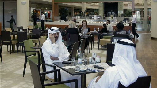 In this Wednesday, May 21, 2014 photo, Emirati and other customers enjoy their free time at the Batee