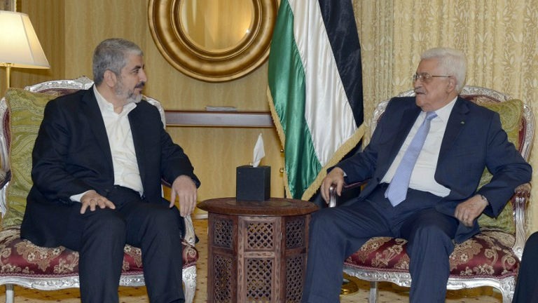 A handout picture released by the Palestinian Authority president's office shows Mahmoud Abbas (right) in a meeting with the head of the political bureau of Hamas, Khaled Mashaal, in Doha, on July 20, 2014. (photo credit: AFP/PPO/Thaer Ghanem)