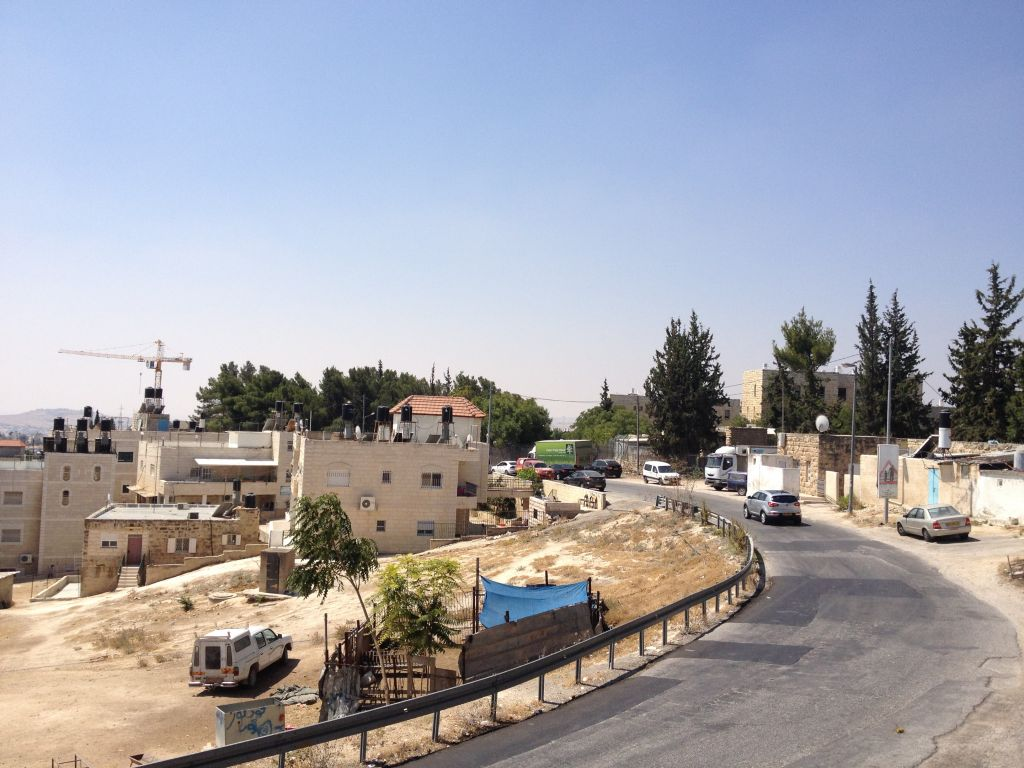 A view of a main street in Jabel Mukaber, one of the Arab villages abutting Armon Hanatziv (photo credit: Jessica Steinberg/Times of Israel)
