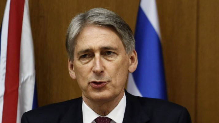 British Foreign Secretary Philip Hammond speaks during a joint press conference with Prime Minister Benjamin Netanyahu on July 24, 2014, at the Knesset. (photo credit:  AFP PHOTO/GALI TIBBON)