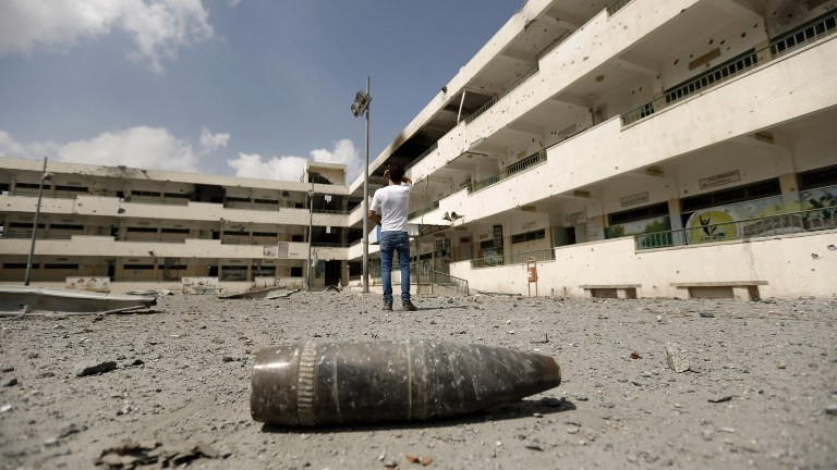 A shell lies on the ground at the heavily damaged Sobhi Abu Karsh school in Gaza City's Shejaiya neighborhood, a Hamas stronghold, Tuesday, August 5, 2014. (photo credit: Mohammed Abed/AFP)