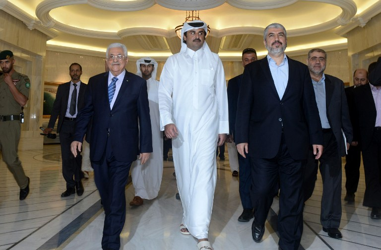 A handout picture released by the Palestinian president's office (PPO) shows Palestinian president Mahmud Abbas (C-L) meeting with Emir of Qatar Sheikh Tamim Bin Hamad al-Thani (C) and Hamas exiled leader Khaled Meshaal (C-R) in the capital Doha on August 21, 2014. (photo credit: AFP PHOTO/ PPO / THAER GHANEM)