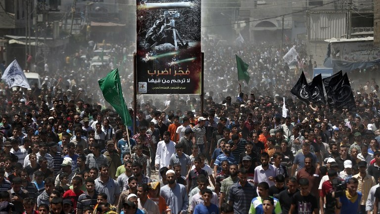 Thousands of Palestinian Hamas supporters follow the body three of Hamas senior commanders during their funeral in Rafah in the south of the Gaza Strip, on August 21, 2014.(photo credit: AFP Photo/Thomas Coex)