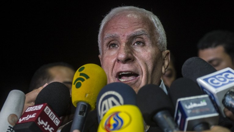 Head of the Palestinian delegation Azzam al-Ahmed gives a press conference at a hotel in Cairo late on August 13, 2014 (Photo credit: Khaled Desouki/AFP)