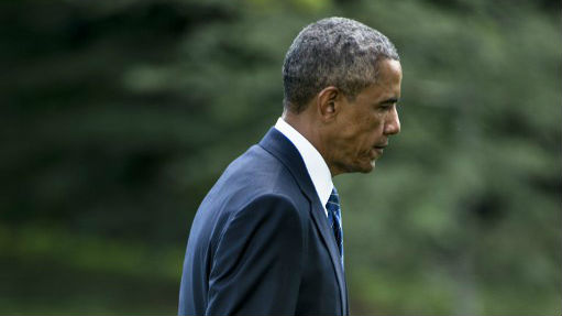 President Barack Obama walks from Marine One on the South Lawn of the White House August 26, 2014 in Washington, DC. (photo credit: AFP/Brendan SMIALOWSKI)