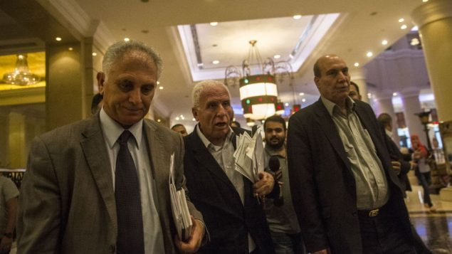 Head of the Palestinian delegation Azzam al-Ahmed and other negotiators gather in Cairo. Getty Images