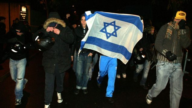 Members of the Jewish Defense League demonstrate in front of the Percy military hospital in Clamart, France. Getty Images.