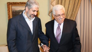 Khaled Mashaal, political leader of Hamas, left, meets with Palestinian President Mahmoud Abbas in Cairo, Egypt, December 21, 2011 (photo credit: AP)