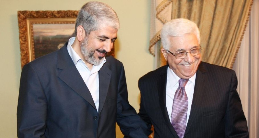 Khaled Mashaal, former political leader of Hamas (left), meets with Palestinian Authority President Mahmoud Abbas in Cairo, Egypt, December 21, 2011. (photo credit: AP)