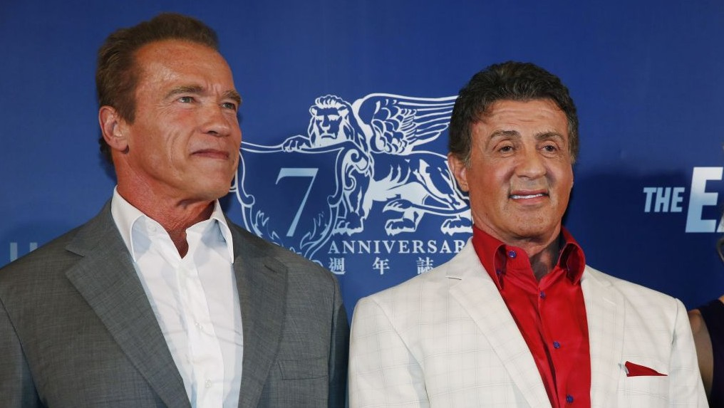 "Arnold Schwarzenegger and Sylvester Stallone pose on the red carpet for the Macau premiere of their movie ""The Expendables 3"" in Macau, China, Friday, Aug. 22, 2014. (photo credit: AP Photo/Kin Cheung)"