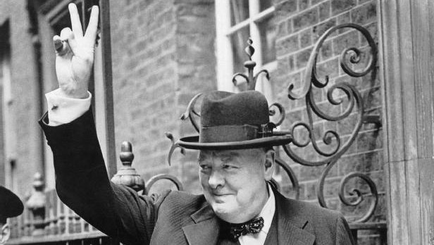 Winston Churchill in Downing Street giving his famous 'V' sign, 1943 (photo credit: Imperial War Museums/public domain)