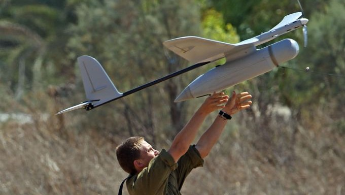An Israeli soldier seen launching a drone, an unmanned aerial vehicle equipped with cameras that produces video images of the battlefield and provides full, aerial real-time intelligence images to forces in the field, on the seventh day of Operation Protective Edge, on July 14, 2014. (Yossi Aloni/Flash90)